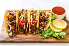 Tacos with meat and vegetables. Mexican food style royalty free stock photos