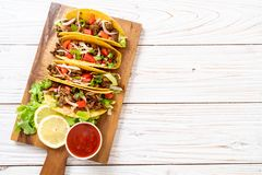Tacos with meat and vegetables. Mexican food style stock photography