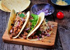 Tacos with minced meat with beans, cheese and onion. Food Stock Photography