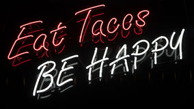 Tacos Neon Sign. A red colored neon sign of a taco Stock Images
