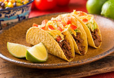 Tacos. A plate of delicious tacos with lime, tomato, lettuce, and cheese Royalty Free Stock Photography