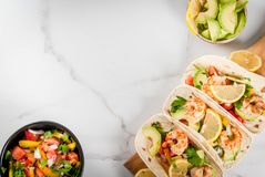 Tacos with salsa and shrimp royalty free stock image