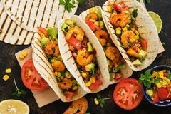 Tacos with shrimp. Traditional Mexican food. Top view royalty free stock photos