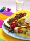 Tacos and tequila. Three tacos with different kinds of stuffing and a tequila shot royalty free stock photos