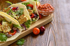 Tacos, tortilla with roasted cauliflower, beans, vegetables and sauce Royalty Free Stock Photo