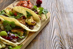 Tacos, tortilla with roasted cauliflower, beans, vegetables and sauce Stock Images