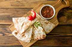 Tacos on wooden background with sauce Stock Photography