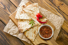 Tacos on wooden background with sauce Royalty Free Stock Photo
