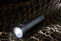 Tactical flashlight Royalty Free Stock Image