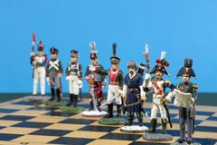 Tactical formation of tin during the Napoleonic wars of 1812. On a chessboard Royalty Free Stock Photos