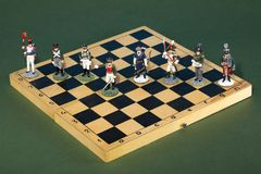 Tactical formation of tin during the Napoleonic wars of 1812. On a chessboard Royalty Free Stock Photo