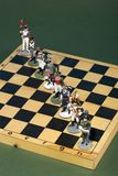 Tactical formation of tin during the Napoleonic wars of 1812. On a chessboard Stock Images