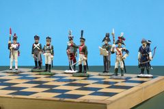 Tactical formation of tin during the Napoleonic wars of 1812. On a chessboard Stock Image