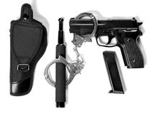 Tactical gear on white background. Gun replica (airsoft), magazine, handcuffs, stick Stock Image