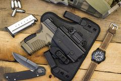 Free Tactical Handgun And Gear Including Watch, Bullets, Knife, Holster, Bag Stock Photos - 121589983