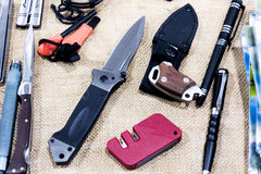 Tactical knife,  pen,  tools. Stock Images