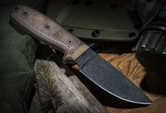 Tactical knife. Tactical or tourist knife with Teflon coated blade and Micarta handle stock photo