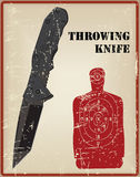 Tactical knife, and a target for throwing knife Royalty Free Stock Image