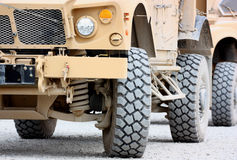 Tactical military vehicle. Front view of military armored tactical vehicle closeup, tire and headlights Royalty Free Stock Photos