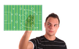 Tactical plan. A young handsome man drawing a tactical plan on a soccer field. All isolated on white background Stock Photography