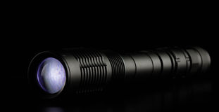 Tactical police and military flashlight on black background Stock Photography