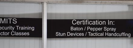 Tactical and Self-Defense Supply Store. A tactical supply store sells batons, pepper spray, stun devices, handcuffs, restraint devices. They also offer gun royalty free stock photo