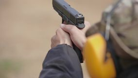 1080 Tactical shooting range, man shoots a pistol on the target. stock video footage