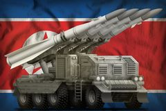 Tactical short range ballistic missile with city camouflage on the Democratic Peoples Republic of Korea North Korea national fla. Tactical short range ballistic stock photos