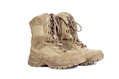Tactical soldiers boots. A pair of tactical soldiers boots in a cut out view Stock Photos