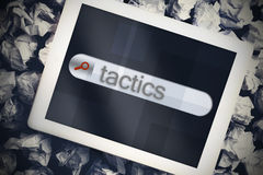 Tactics in search bar on tablet screen Stock Photo