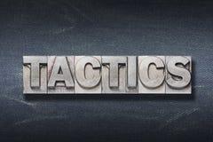 Tactics word den Royalty Free Stock Image