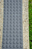 Tactile Paving For Blind Handicap. Grey Colored Tactile Paving For Blind Handicap Stock Photography