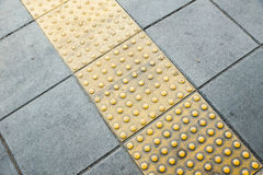 Tactile paving for blind handicap Royalty Free Stock Images