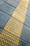Tactile paving for blind handicap Stock Photos