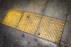 Tactile paving for blind handicap Royalty Free Stock Photos