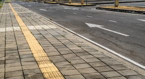 Blind tactile way. Tactile paving for blind handicap on concrete block pathway Royalty Free Stock Images