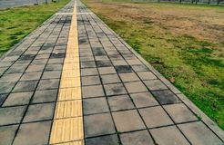 Blind tactile way. Tactile paving for blind handicap on concrete block pathway Stock Photography