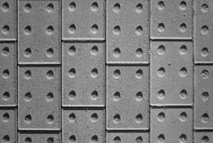 Tactile Paving Bricks Provide a Black and White Abstract Background. Tactile paving bricks with shadow detail photographed and processed in black and white to Stock Photo