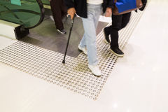 Tactile paving path for the blind entrance exit of escalator Royalty Free Stock Images