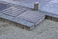 Tactile paving, path for blind handicap on the sidewalk Royalty Free Stock Photography