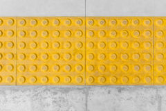 Tactile paving or Tile footpath for blind Stock Image