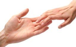 Tacto de las manos del hombre y de la mujer Imagen de archivo libre de regalías