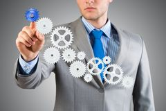 Tacto del hombre de negocios el mecanismo Fotos de archivo