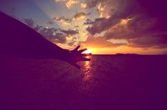 Tacto del Sun Imagen de archivo libre de regalías