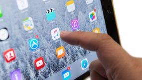 Tacto en la música de Apple foto de archivo