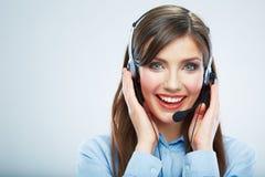 Tacto sonriente del operador de centro de atención telefónica de la mujer headsed Ci?rrese encima de b Foto de archivo libre de regalías