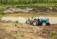Tactor Water Pump. Tractor with a water pump on the back of it Stock Photography