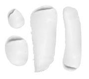 Tactos de la crema cosmética aislados en el fondo blanco foto de archivo libre de regalías