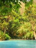Tad Kuang Si waterfall in forest next to Luang Prabang, Laos Royalty Free Stock Photo