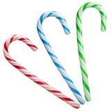 Tadelloser Bonbonstock gestreift in den Weihnachtsfarben lokalisiert auf einem weißen Hintergrund nahaufnahme Stockfotografie